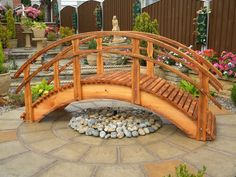 There are many uses for a wooden garden bridge which will instantly enhance the beauty of your pond or garden. Pond Bridge, Garden Bridge, Ponds Backyard, Backyard Landscaping, Backyard Waterfalls, Garden Ponds, Koi Ponds, Pond Design, Landscape Design