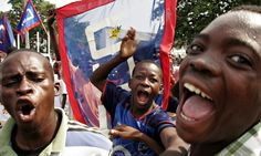 Government supporters campaign in Kinshasa before the 2006 election.  Photograph: Anjan Sundaram/AP