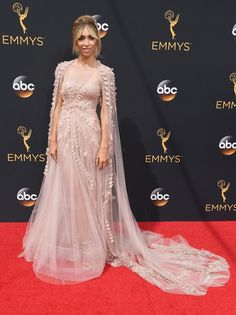 Giuliana Rancic Princess Gown - Giuliana Rancic made a grand entrance at the Emmys in a princess-worthy pale-pink Georges Chakra Couture gown, boasting a flowing cape and ruffle appliques.