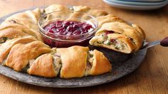 Cranberry Turkey Crescent Ring. Cooked turkey, spinach leaves, Swiss cheese, whole cranberry sauce, refrigerated crescent rolls. Appetizers. Brunch. Thanksgiving leftovers. Potluck. Pillsbury