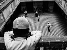 Tale out of School Photograph by Siddhartha Banerjee, National Geographic Your Shot Picture of a boy looking over a balcony into a courtyard, Kolkata, India