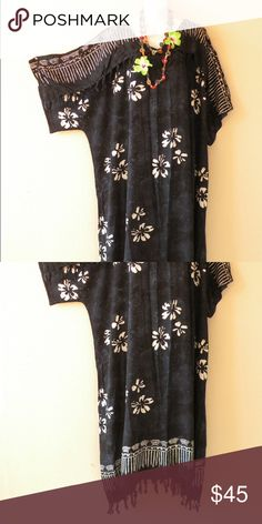 Navy Blue Batik Hibiscus Abaya Kaftan Kimono Dress The kimono sleeve dress has been popular in the USA for decades. This comfortable flowy dress can be worn on almost any occasion and by a woman with any type of figure. It will make a great addition to a wardrobe to wear at any seasons.  Necklace is not included.  Chest : 65 inches Hip : 72 inches Length : 51 inches including fringes Sleeve Length : 13 inches Fringes : 2 inches on the chest-line & hem Material : Supersoft Premium Rayon Fit…