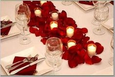 we could easily bring in some rose petals to the restaurant and also ask if we can light votives maybe?