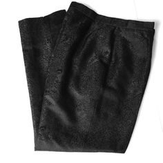 Rena Rowan black jacquard pants  HP 5/11 Rena Rowan black jacquard pants in a size 12 petite. Excellent condition. Worn once to event. Fabric is dark dressy black. Waist 15 1/2, hips were 21 inches, front rise 12 1/2, thigh at crotch is 13 inches, tapers to 11 inches above knee and 7 1/4 at ankle, inseam 28 inches. Rena Rowen Pants Straight Leg
