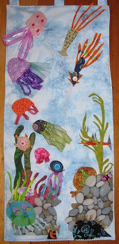 themed quilt hanging- a nice change from the separated block style. - could be done as a collage