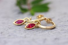 Shop for Antique style unique solid gold hoop and pendant earrings in 14k, 18k or 22k yellow / 14k white or rose gold with marquise Rubies, Boho gold stud hoop earrings. These earrings have a delicate ethnic style. This 14K, 18k, or 22k gold hoop earring set has each a vintage style pendant hanging from a wide gold hoop. Each pendant is adorned with a marquise Ruby in the center.