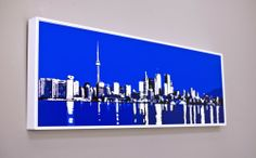 Toronto Skyline – Lorie Slater $275  In stock  Category: Photography.Product Description  Dimensions - 12″ x 36″     Website: lorieslater.com