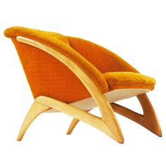 Orange Curved Loungechair with sculptural frame | From a unique collection of antique and modern lounge chairs at http://www.1stdibs.com/seating/lounge-chairs/