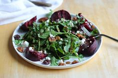 Roasted Beet Salad with Maple Cinnamon Balsamic Vinaigrette, goat cheese, and candied pecans and cranberries