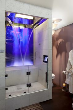"""Experience Shower with 4 programmed light and sound settings. Cascading waterfall, 24"""" showerhead, misters and body jets"""