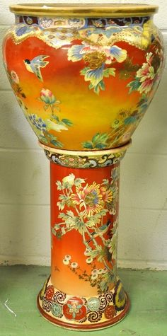 A LARGE LATE 19TH CENTURY JAPANESE SATSUMA JARDINIERE ON STAND painted with flowers and birds. 3ft 6ins high.