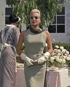 Imitation of Life - Lana Turner - olive halter dress - Jean Louis/ this movie is like a Lana fashion show.
