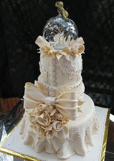 Ivory lace tiered fondant wedding cake,so nice!.......some of the detail here, but no exactly this...