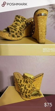Michael Kors belinda wedges Leopard color Golden hardware. Center seam on vamp. Open toe. Leather insole. Side stud detail reminiscent of clog style. Cork platform. 3 1/2 cork wedge heel  Only use one time  its a 10 but fits like a size 9  beautiful shoe Michael Kors Shoes Wedges
