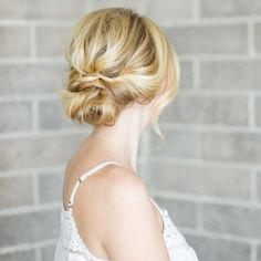 A super easy, 10 step hair tutorial that's perfect for the summer heat! Learn how to do a chic low bun from Kacee Geoffroy!