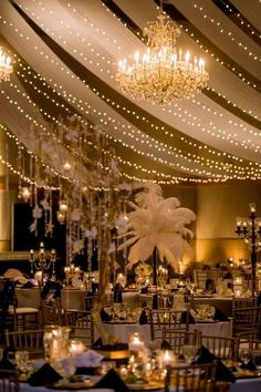 gatsby party, feathers, white sheers, and lights.