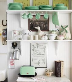 If you have a colorful collection of something, group them together and consider pulling in an outside accessory in a similar shade to round out the look.    Source: Laura Moss for Country Living