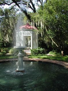 Fountain and summer house in the formal gardens at Rosedown Plantation, St Francisville LA