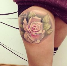Cute pastel pink rose thigh tattoo