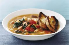 A colorful and satisfying stew is priceless this time of year, and you can't do much better than a tomatoey broth full of hearty cannellini beans, baby greens, and cubes of baked ham.