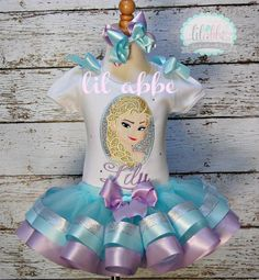 My daughter's second birthday outfit made by Lil Abbe Frozen Elsa tutu outfit