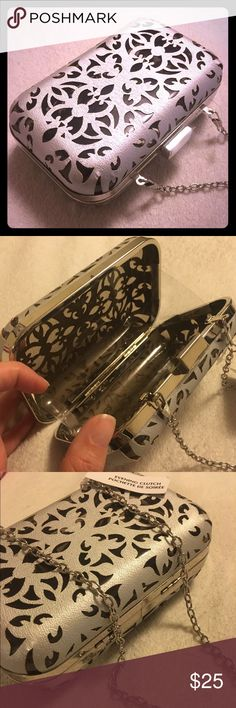 """Silver / Clear Hard Clutch Hard case clutch laser cut in silver / light gray with silver tone hardware.measures 6""""x4""""x2"""" @sweeti Bags Clutches & Wristlets"""