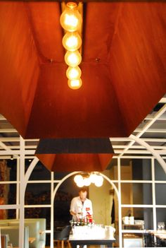 Neptune Food & Wine Bar - Custom Trough Pendant Lights #lights #pendantlights #pendantlight #interiordesign #design #restaurant #cafe #hospitality #restaurantdesign #restaurantinterior #interior #bar #bardesign #barinterior #rust