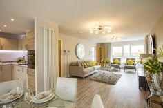 The fabulously spacious L-shaped living / dining / kitchen of the Burnet at Midton Fields, Howwood