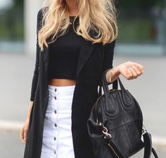 White denim button up skirt, black long sleeve crop top, and sleeveless black coat