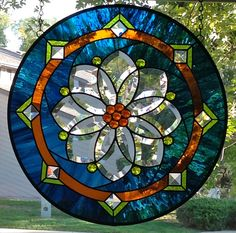 Round Stained Glass Window Panel with Flower Bevel by AmberglassStudio on Etsy https://www.etsy.com/listing/166134843/round-stained-glass-window-panel-with