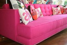 """Yummy pink sofa--love the letter pillows.....could be very interesting. Will make some. The photo is backwards! Pillows say Hugs. Love the tie pillow also, Make Tie end """"Houses"""" on a pillow."""