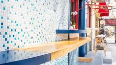 an 'urban surf' concept drove the design for the new poke poke restaurant in shanghai by studio doho, reflecting its hawaiian origins. Cafe Design, Interior Design Studio, Surf Cafe, Bar, Commercial Interiors, Decorating On A Budget, Home Decor Styles, A Boutique, Country Decor