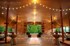 Our open air dancehall with stage, bar and dance floor. In this shot, it was set up for a bridal fashion show. Remove the runner and the chairs off the dance floor and dance the night away!