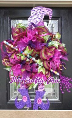 Wreath by TheCraftyChicByKimi http://www.etsy.com/listing/159953359/halloween-bling-witch-wreath You won't be scaring the kiddos this year with this whimsical wreath, she's an eye catcher! She's loaded with lots of Bling, Shiny Ribbon plus Glitzy Sticks and a fun Fuchsia Glitter Strip that were purchased at http://www.trendytree.com She has a Blinged out Broom any Good Witch would be happy to ride and measures 3 ft long. #trendytree #halloween #wreath