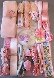 Crazy Quilt Embellishment Assortment - Pink Light  Light Pink Crazy Quilt Embellishment Assortment - A variety of vintage and new materials. Each light pink assortment is one of a kind and unique, and may include some of the following items: ribbons, trim, lace, pearl buttons, venise, embroidery thread, and even old stamps. Let us choose an assortment for you.  Price: $30.00