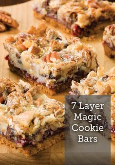 These Seven Layer Magic Cookie Bars are the best thing ever! They've got walnuts, pecans, chocolate, raspberry flavor and more. Yum! It's a cookie bar recipe you'll want to remember.