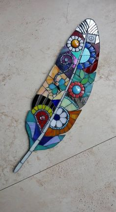 Just love the jewel-like colours on this feather. I coud imagine this adorning part of a wlled garden, with a comfy bench and some shade for a meditation focused on colour, shape and form. Mosaic feather absolutely beautiful i want this so bad Garden Art Mosaic Garden Art, Mosaic Tile Art, Mosaic Rocks, Mosaic Artwork, Mosaic Diy, Mosaic Crafts, Mosaic Projects, Mosaic Glass, Mosaic Mirrors