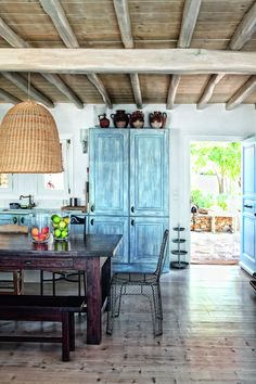 Blue wash cabinets + wicker lighting in cottage kitchen via DECONOW
