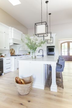 Lakeview Home Kitchen Reveal + Modern kitchen pendants + Vanilla Milkshake cabinetry Benjamin Moore + Gray counter stools + wide plank wood floors | Scout & Nimble