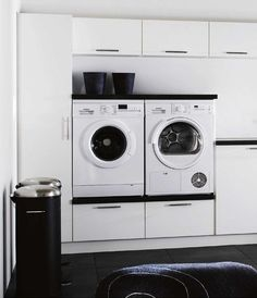 Designing the ultimate laundry, all the tips and tricks you need! Stylish black and white laundry with appliances elevated off the ground for ease of access