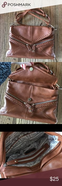 Brown vegan crossbody bag Brown faux leather medium sized cross body purse. Has a braided zipper front. Has a clasp open to a zipper pouch. Zips on one side and has 2 pockets on the other side. Zips on the back. Has an adjustable belt strap or clips to take off the strap. Has a few small spots of wear around the edges and on the braid. Still in GREAT condition...has a slightly funny smell inside. From urban expressions and 100% vegan certified. Retails around $80. Urban Expressions Bags…