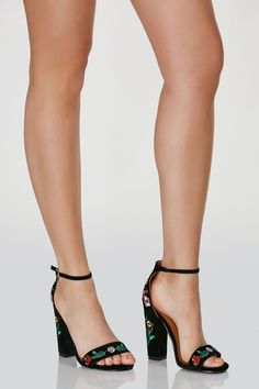 Chic ankle strap pumps with soft velour finish. Intricate floral embroidery throughout.
