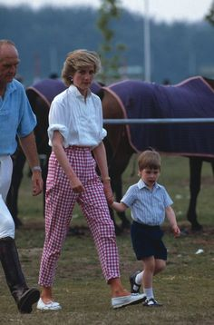June Princess Diana with Prince William and Major Ronald Ferguson at Guards Polo Club, Windsor. Diana wearing pink gingham trousers, white shirt and loafers. Princess Diana also wore this outfit in