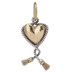 Wrapped in love! Sterling silver rope gracefully adorns a heart of brass. A piece meant to stand the test of time.     Solid Brass with Sterling Silver     Charm is 1 inch Long