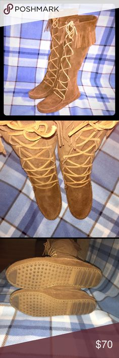 Minnetonka Knee-High Moccasins Worn Once  Practically new- Worn Once. Knee-high Lace up Moccasins w/ Fringe. Excellent Used Condition- 100% Genuine Leather. Minnetonka Shoes Winter & Rain Boots