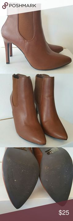 Tan Heeled Bootie Sz 8 Tan Heeled Bootie Sz 8. Never worn. Breckelles Shoes Heeled Boots