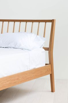This bed frame was inspired by the classic windsor dining chair. A slanted headboard makes early morning reading or late-night movie watching all the more comfortable. Headboard and footboard a Minimalist Bed, Minimalist Home Decor, Bedroom Furniture, Home Furniture, Furniture Design, Furniture Dolly, Girls Bedroom, Bedroom Bed, Master Bedroom