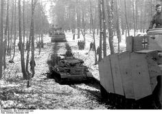 Column of PzKpfW IV Ausf.G and Tigers of the 2. SS-Panzer-Division 'Das Reich' marching through a snowy forest, near the city of Kirovohrad, 250 km southeast of Kiev, to combat the forces of the 1st Ukrainian Front. Ukraine. 1 December 1943. | Flickr - Photo Sharing!