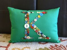 monogrammed pillow with buttons
