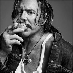 Mickey Rourke smoking a Cigar - even with this face I still love him so much. - D.S.
